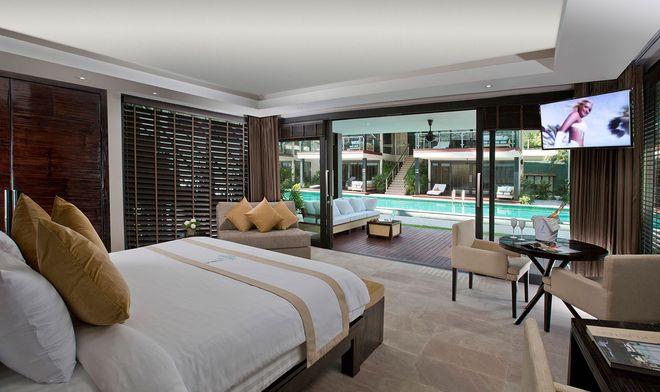 Vaste chambre moderne avec vue sur la piscine lors du voyage tout compris en Thaïlande en vente privée Idiliz. Séjour d'une semaine pas cher en Thaïlande .